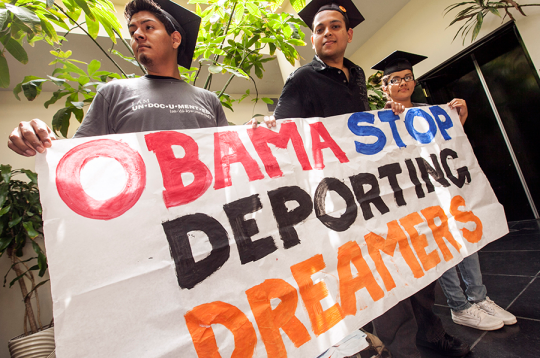 Students protest outside the Obama campaign offices in Culver City, Calif., June 14, 2012 / AP Images