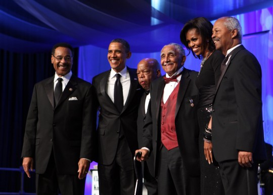 CBC members pose with the Obamas (AP)