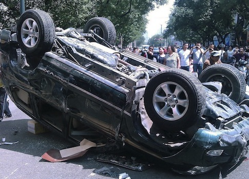 Over-turned Japanese-branded car / AP