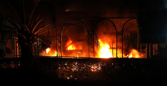 A car burns after it was set on fire inside the US consulate compound in Benghazi late on Sept. 11, 2012. (Getty Images)