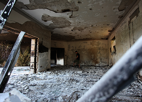 A Libyan man walks in the rubble of the damaged U.S. consulate on Thursday, Sept. 13, 2012, after an attack that killed four Americans, in Benghazi, Libya. (AP)