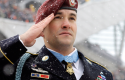 Former Staff Sgt. Salvatore Giunta salutes during the National Anthem before a December 2010 Bears-Patriots game in Chicago. (AP)