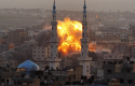 Smoke rises during an explosion from an Israeli forces strike in Gaza City / AP