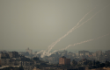 Smoke trails off rocket fired by Palestinian militants from Gaza Strip towards Israel, Oct. 24, 2012 / AP