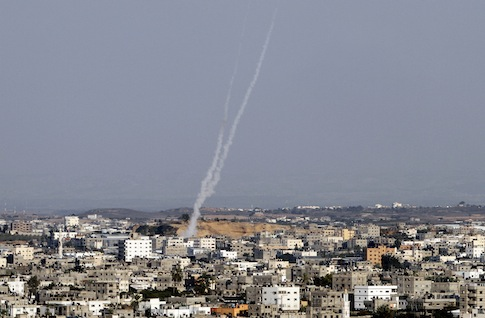 Smoke trails are seen after missiles were fired by Palestinian militants from Gaza City towards southern Israel / AP