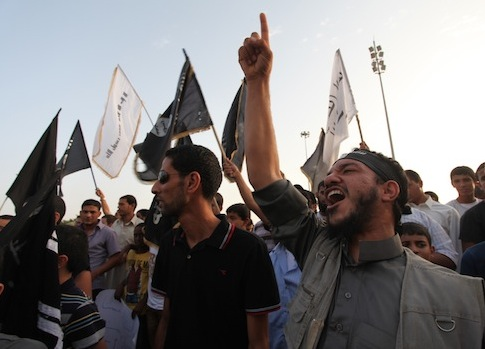 Libyan followers of the Ansar al-Shariah Brigades chant anti-U.S. slogans during a protest / AP