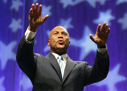 The suit challenges legislation signed by Deval Patrick, then the state's governor, prior to last year's midterm election. / AP