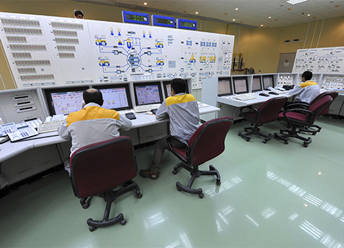 Iranian technicians work at the Bushehr nuclear power plant in Iran / AP