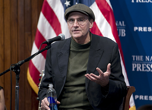 James Taylor speaking at The National Press Club / AP