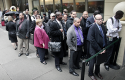 Job seekers wait in line to see employers at a National Career Fairs&#039; job fair in New York / AP