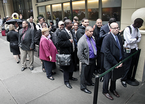 Job seekers wait in line to see employers at a National Career Fairs' job fair in New York / AP