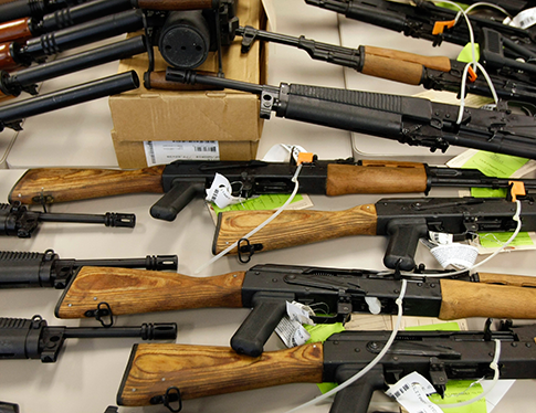 A cache of seized weapons displayed at a news conference in Phoenix in 2011, during the Fast and Furious investigation. (AP)