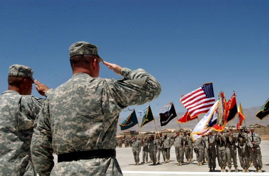 U.S. military officers salute their color guards during a ceremony marking the U.S. Army's 231st birthday at the U.S main base in Bagram, north of Kabul, Afghanistan on June 14, 2006 / AP