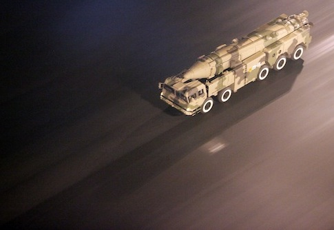 A missile launcher drives down a street in Beijing, China / AP