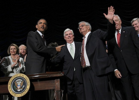 Barack Obama, Barney Frank, Chris Dodd the day Dodd-Frank was signed by the president / AP