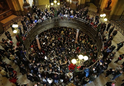 Illinois state union members and supporters rally in support for fair pension reform / AP