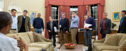 President Barack Obama talks to men on his staff / White House Flickr