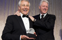 Hagel giving Clinton an Atlantic Council award (2010) / AP