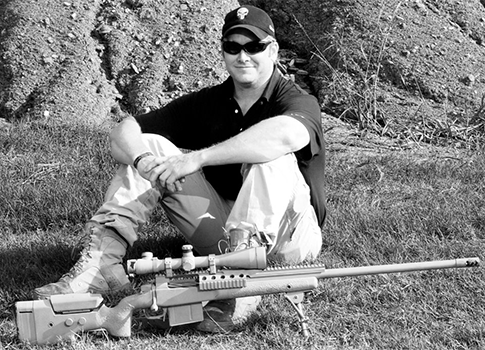 Kyle with his Lapua .338, the gun used to make his longest kill / Facebook