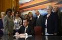 Colorado Gov. John Hickenlooper signing gun control legislation (AP)