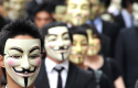 Anonymous members wearing Guy Fawke&#039;s masks / AP