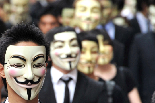 Anonymous members wearing Guy Fawke's masks / AP