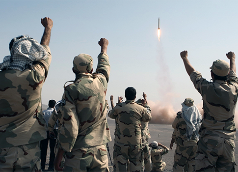 Iranian Revolutionary Guard celebrate after test launching a missile in Iran, July 3, 2012