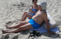 Soros and GF on beach / Splash News