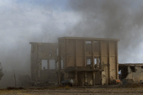 Smoke rises from an explosion in an al Qaeda training camp / AP
