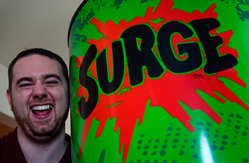 Eric Karkovack laughs next to a Surge cooler in 2005, in his Carlisle, Pa., home. (AP)