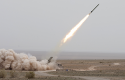 A missile is launched during an Iranian army exercise in central Iran in March / AP