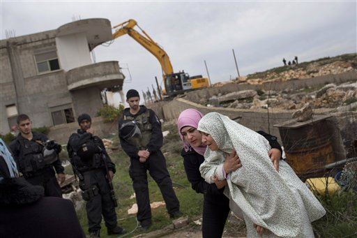 Israelis demolish home lacking permits (AP)