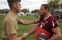 Brandon O&#039;Brien, right, accepts the Navy and Marine Corps Medal in 2011 / AP