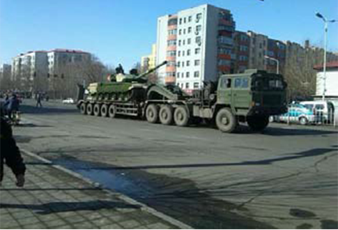 Chinese Internet photo of a truck carrying a tank en route to an area near North Korea