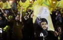 Hezbollah supporters wave the party&#039;s flags in 2011 / AP