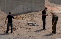 Israeli security investigates the scene of a rocket attack in Eilat, Israel, Wednesday, April 17, 2013. (AP)