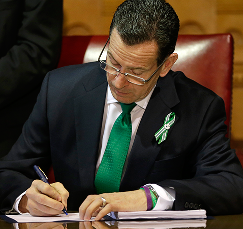 Gov. Dannel Malloy signs into law Connecticut's strict new gun laws. (AP)