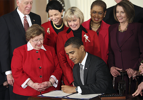 Obama signing Lilly Ledbetter Bill in 2009 / AP