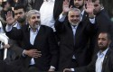 Reelected Hamas chief Khaled Meshal, left, and Gaza&#039;s Hamas Prime Minister Ismail Haniyeh / AP