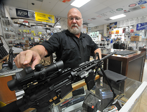 Victor Valley Shooters owner Jay Stedt at his store in Victorville, Calif., in December. (AP)