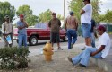 Padro Garcia waits for work with fellow illegal immigrant day laborers Thursday, July 22, 2010 (AP)