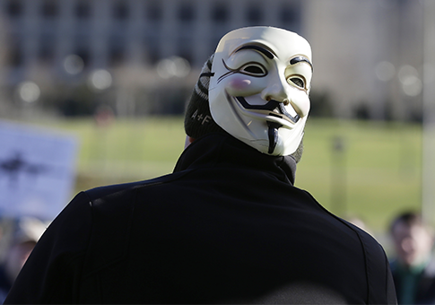 Guy Fawkes mask associated with Anonymous / AP