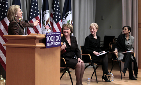 Secretary of State Hillary Clinton gestures as a panel at the 100 Women Initiative looks on at the State Department in 2011. (AP)