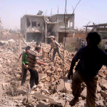 Syrians inspect rubble of damaged buildings due to government airstrikes, in Qusair, Syria. The town has been besieged by regime troops and pro-government gunmen backed by Hezbollah. (AP)