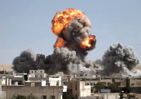 Smoke and fire rises after explosives were dropped by a Syrian government warplane in Yabroud near Damascus, Syria / AP