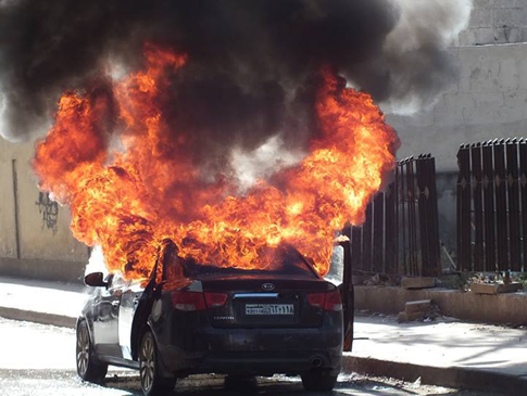 A car attacked by Syrian government forces, whom Hezbollah has been assisting. (AP/Aleppo Media Center, AMC)
