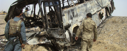 Burned bus after it collided with the wreckage of a truck that was attacked by Taliban insurgents in Afghanistan / AP