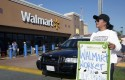Protester outside a Walmart store in November 2012 / AP