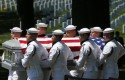 Navy honor guard members carry the casket for Vietnam War sailors missing from the Vietnam War on May 2, 2013 / AP