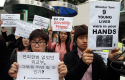 South Korean protesters stage a rally urging China to stop repatriating North Korean defectors. (AP)